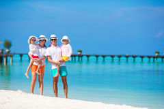 Happy beautiful family on white beach during Stock Photography