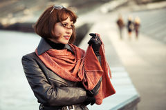 Happy beautiful fashion woman in leather coat outdoor Stock Photos