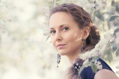 Happy beautiful fashion woman walking in a spring garden Royalty Free Stock Photos
