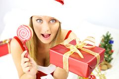 Happy beautiful female santa claus with gift Royalty Free Stock Photos