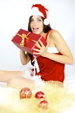 Happy beautiful female santa claus ready to bring Royalty Free Stock Images