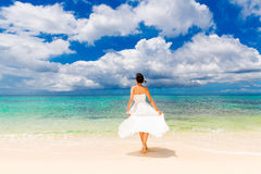 Happy beautiful fiancee in white wedding dress on shore sea. Wed Royalty Free Stock Image