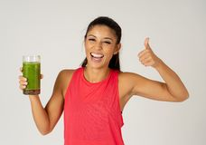 Happy beautiful fit sport woman smiling and drinking healthy fresh vegetable smoothie stock images