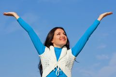 Happy beautiful girl against the blue sky Royalty Free Stock Photography