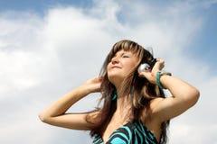 Happy beautiful girl on background of skies Stock Image
