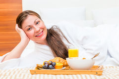 Happy beautiful girl on the bed Royalty Free Stock Photos