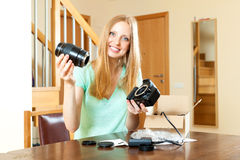 Happy beautiful girl with blond hair with new digital camera at Royalty Free Stock Photo