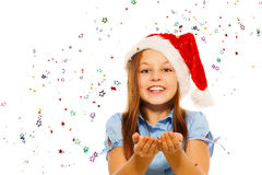 Happy beautiful girl blow confetti and smile Royalty Free Stock Image