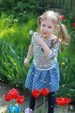 Happy beautiful girl blowing dandelion, having fun and playing outdoor, teen girl enjoying nature Royalty Free Stock Photography