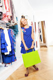 Happy beautiful girl in blue dress at the store Stock Photo