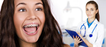 Happy beautiful girl with braces. stock photos