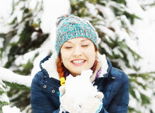 Happy beautiful girl dressed in blue jacket has fun in winter Royalty Free Stock Photos