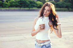 Happy beautiful girl drinking ice coffee on the sunset Royalty Free Stock Photo