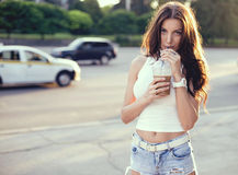 Happy beautiful girl drinking ice coffee on the sunset Royalty Free Stock Photos