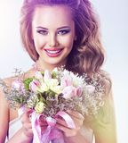 Happy beautiful girl with flowers in hands royalty free stock photos