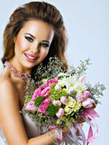 Happy beautiful girl with flowers in hands Stock Photo
