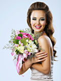 Happy beautiful girl with flowers in hands Royalty Free Stock Image
