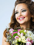 Happy beautiful girl with flowers in hands Royalty Free Stock Photo