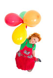 Happy beautiful girl flying with baloons Royalty Free Stock Photo
