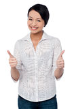 Happy beautiful girl giving two thumbs up. Half-length portrait of two hands thumbing up woman Stock Image
