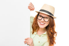 Happy beautiful girl with glasses and a hat Stock Image