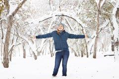 Happy beautiful girl has fun outdoors in park Royalty Free Stock Photo