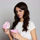 Happy beautiful girl with heart gift box Royalty Free Stock Photo