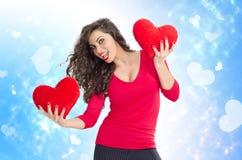 Happy beautiful girl holding plush hearts Stock Photo