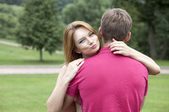 Happy beautiful girl hugging her favorite guy Royalty Free Stock Image