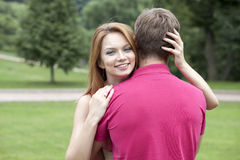 Happy beautiful girl hugging her favorite guy Stock Photography