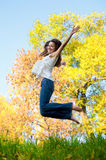 Happy beautiful girl jumping Royalty Free Stock Image