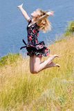 Happy beautiful girl jumping into the air Stock Photography