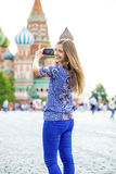 Happy beautiful girl photographed on a cell phone Royalty Free Stock Photos