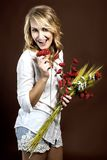 Happy beautiful girl with plastic red poppies and corn cobs Stock Image