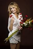 Happy beautiful girl with plastic red poppies and corn cobs Stock Images