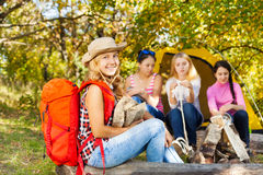 Happy beautiful girl with red rucksack sitting Royalty Free Stock Photo