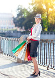 Happy beautiful girl with shopping bags in the city Royalty Free Stock Photography