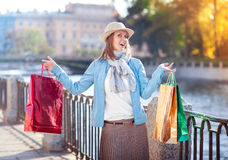 Happy beautiful girl with shopping bags in the city Royalty Free Stock Photo