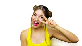 Happy beautiful girl showing peace sign on her eye on white background royalty free stock image