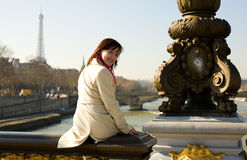Happy beautiful girl sitting on bridge balustrade Stock Images