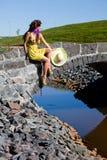 Happy Beautiful Girl Sitting On stone bridge Stock Photography