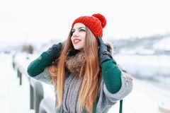 Happy beautiful girl smiling and looking up in stylish winter cl Stock Images