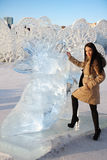 Happy beautiful girl stands near big ice shoe Stock Image