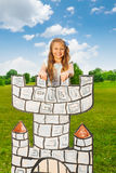 Happy beautiful girl stands on top of drawn tower Royalty Free Stock Photos