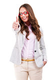 Happy beautiful girl in stylish red glasses showing thumb up Royalty Free Stock Images