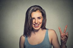 Happy beautiful Girl With Victory Sign Royalty Free Stock Photography