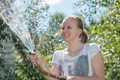 Happy beautiful girl and water Stock Photography