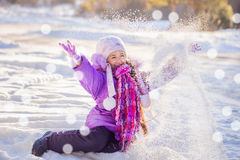 Happy beautiful girl in winter park Stock Image