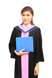 Beautiful graduation girl holding her diploma Royalty Free Stock Image