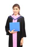 Beautiful graduation girl holding her diploma. Happy beautiful graduation girl holding her diploma Royalty Free Stock Image